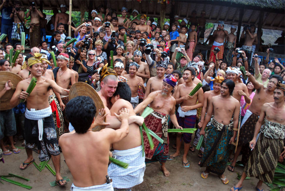 A tourist participating a traditional battle with local man in Makare-Kare