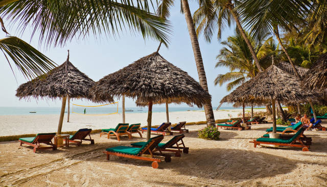 Shaded loungers under the palm trees, facing the Indian Ocean. Pinewood Beach Resort, Mombasa.
