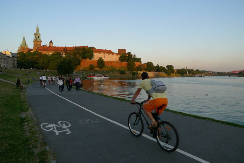 Cycling in Bulwar Kurlandzki on Vistula River close to Krakow Castle