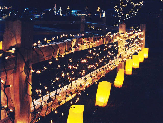 This is a New Mexico tradition for Christmas. These are the electric kind, but usually they are made from ordinary brown lunch bags with a votive candle sitting in a small amount of sand inside.