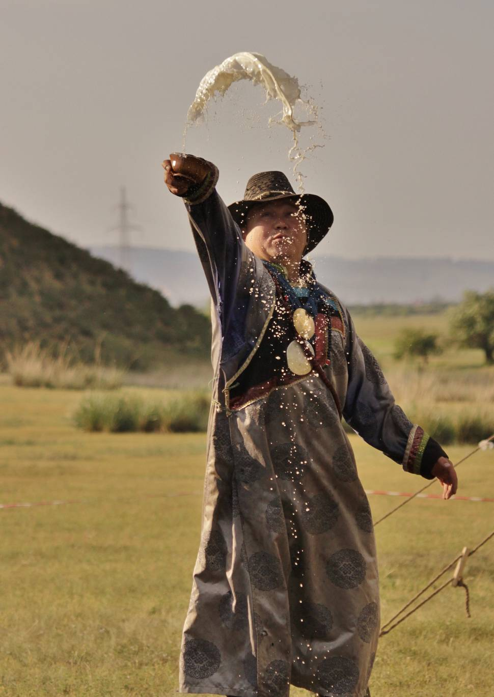 Shaman makes offerings to the local spirits