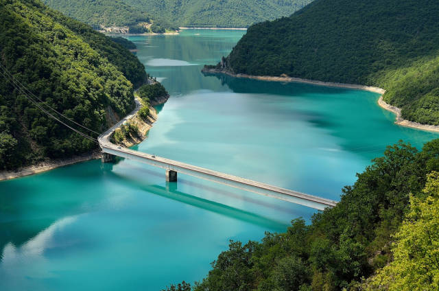 View on colourful Pivsko Jezero, from where the road starts through Durmitor