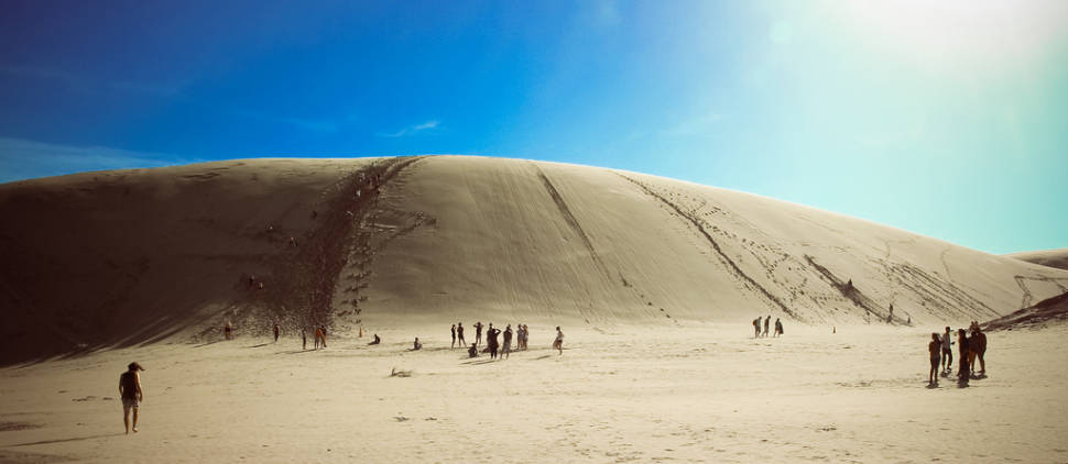 Body Board Down the Sand Dunes in New Zealand - Best Time