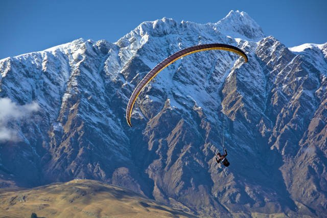 Paraglider with Queenstown Hill and Remarkables Double Cone