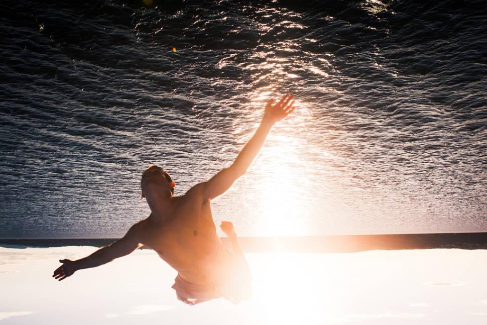 Swimming in the Midnight Sun in Norway - Best Season