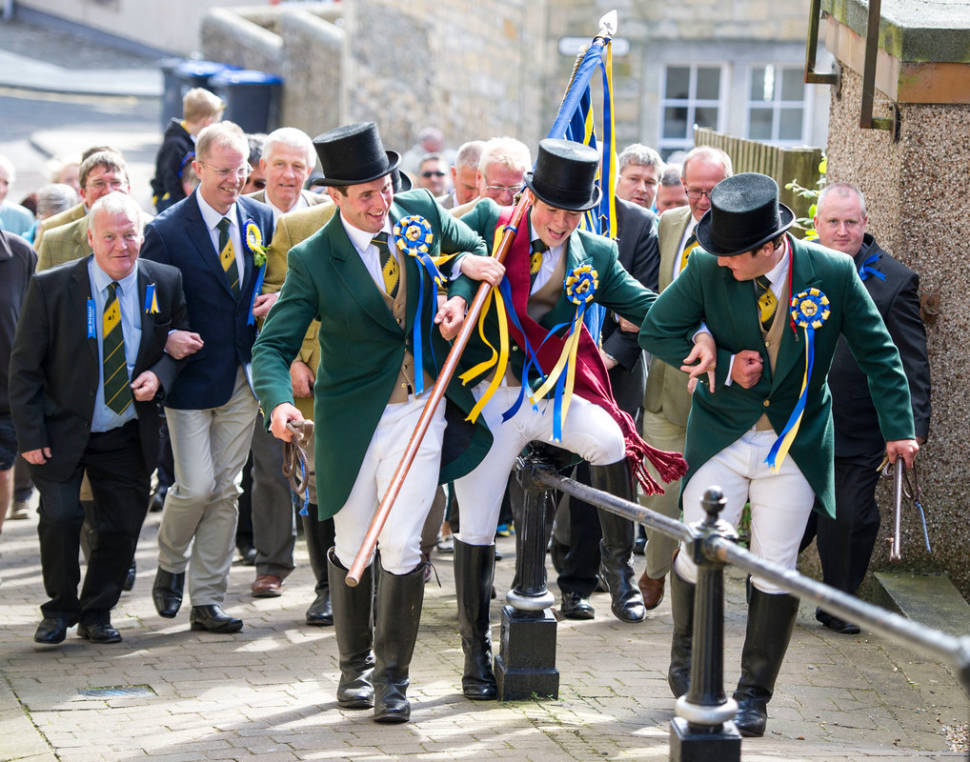 Hawick Common Riding. Cornet Gregor Hepburn carries the flag to the town hall