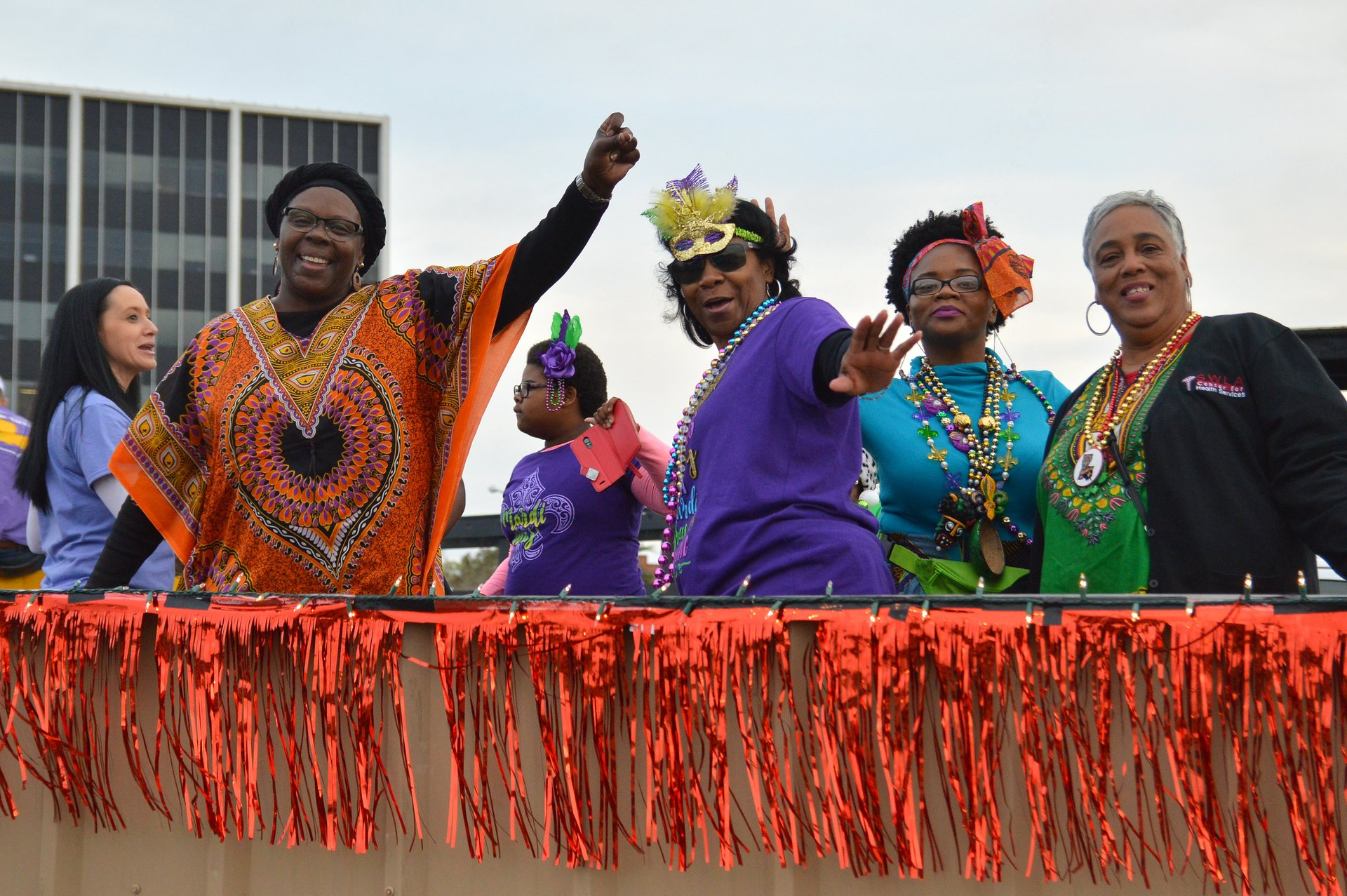 Waving from the float. The setup scene to the Merchants' Parade in Lake Charles 2020