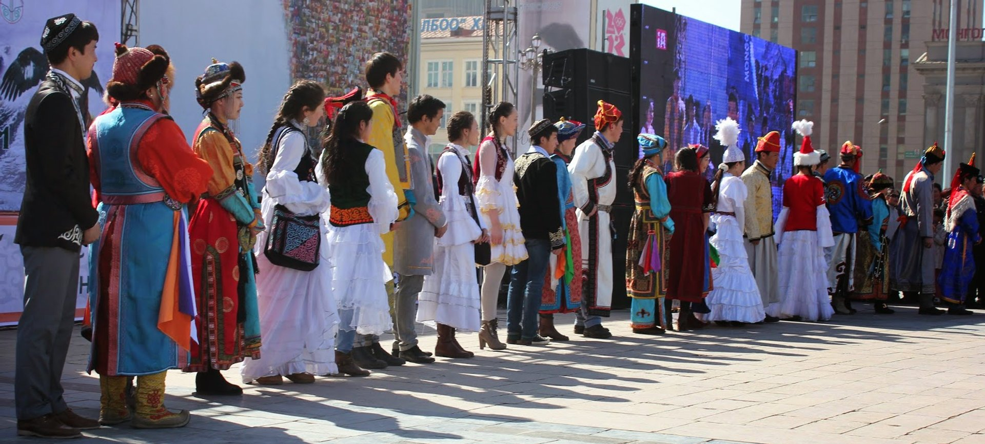 A parade of Kazakh young men and women in traditional costumes 2020