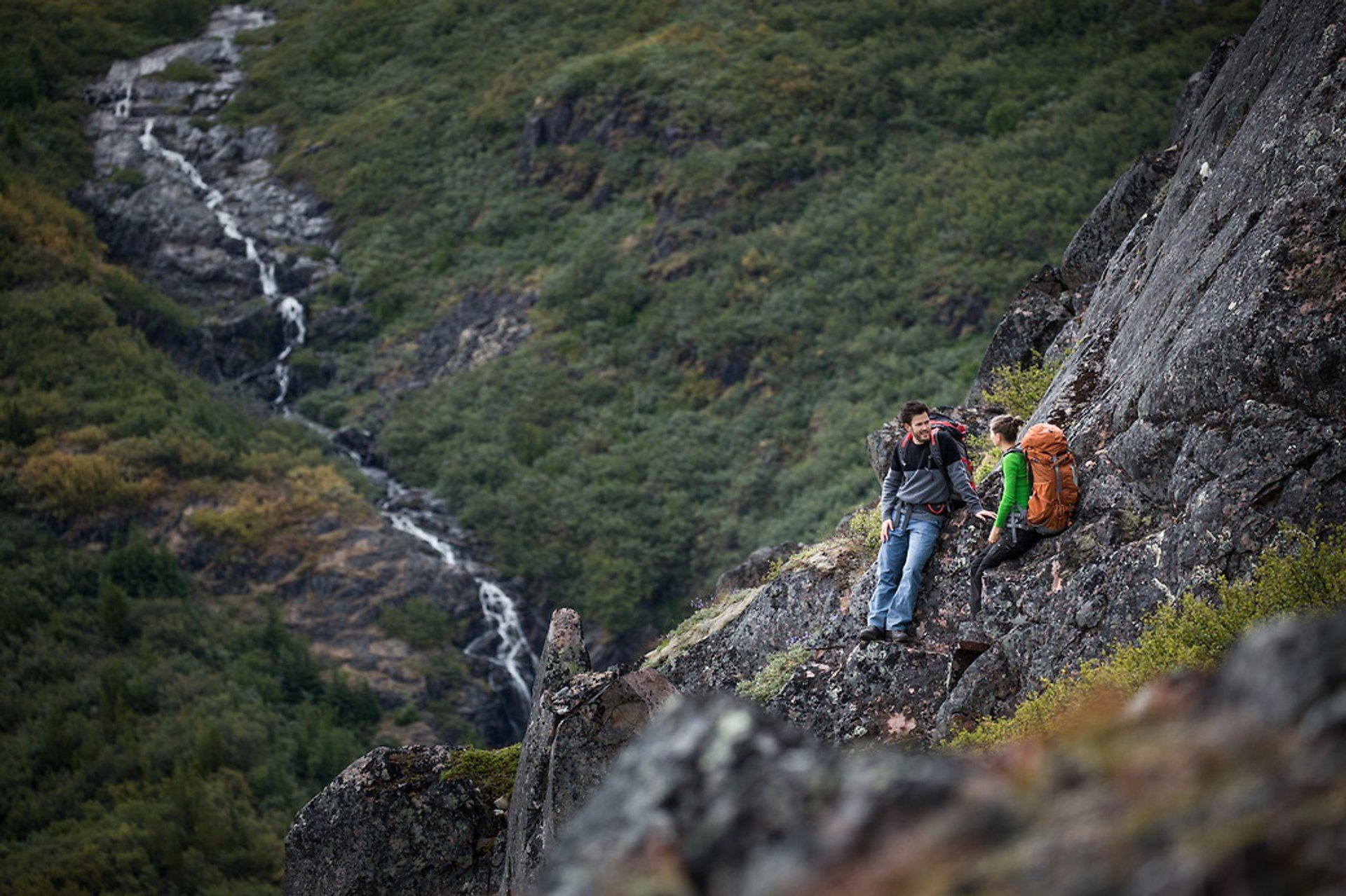 Hikers near a waterfall in Narsarsuaq