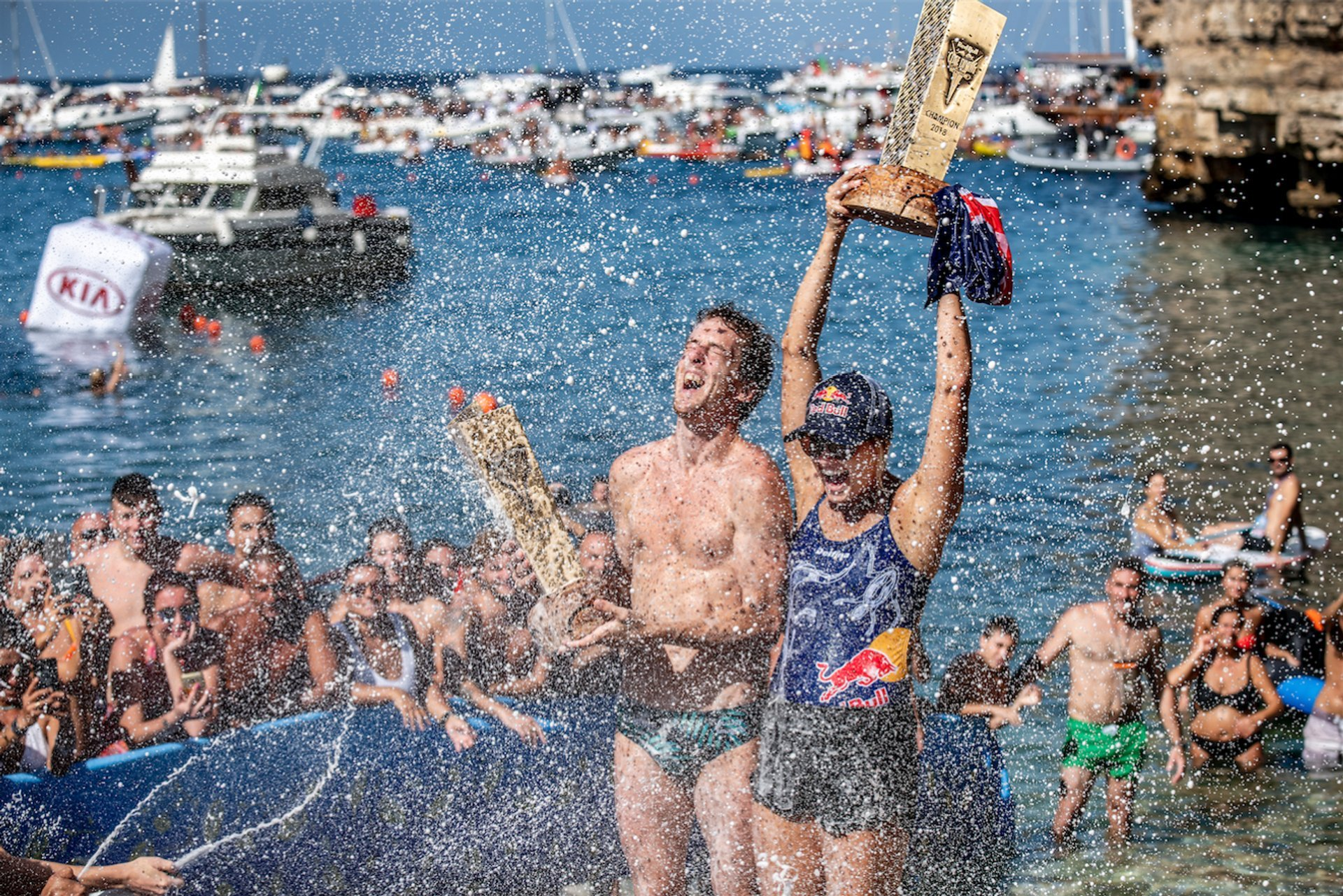 World Series winners—Gary Hunt (UK) and Rhiannan Iffland (Australia) celebrate with the King Kahekili trophies in Polignano a Mare, Italy 2020