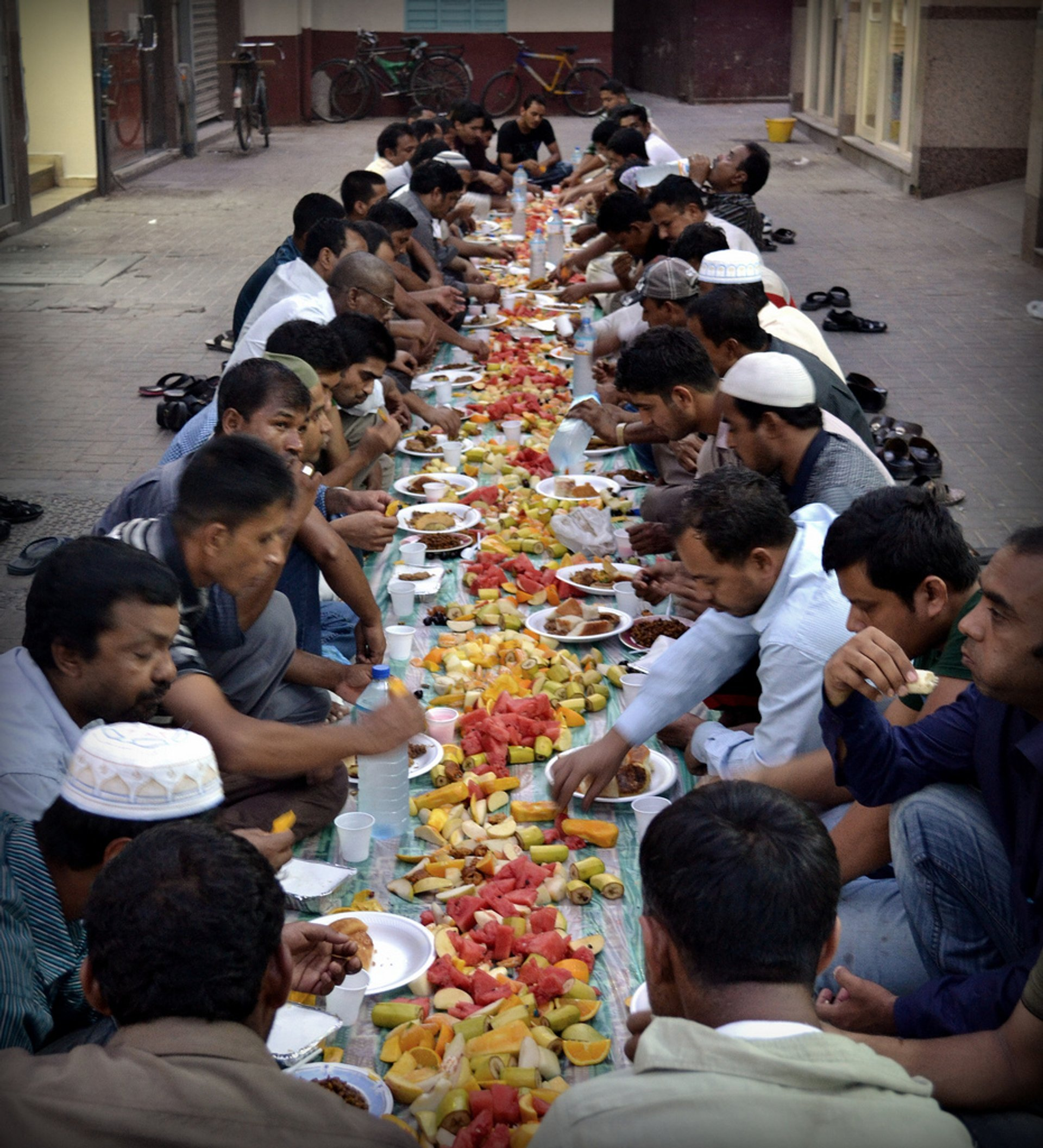 When the night comes people stop to fasting, sitting on street and eat a meal together 2020