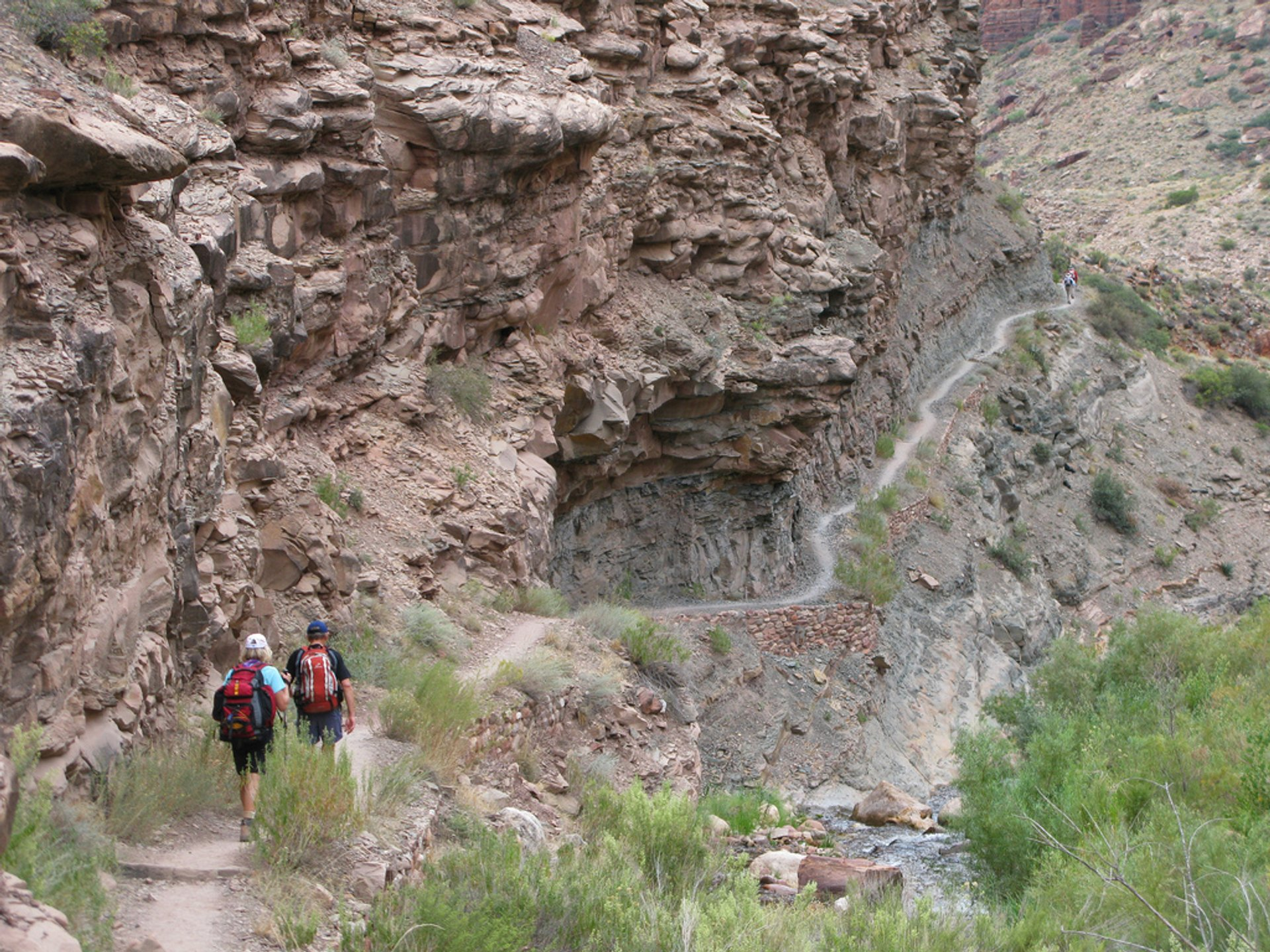 Backpackers just below Cottonwood Campground on the North Kaibab Trail descending deeper into the Grand Canyon 2020