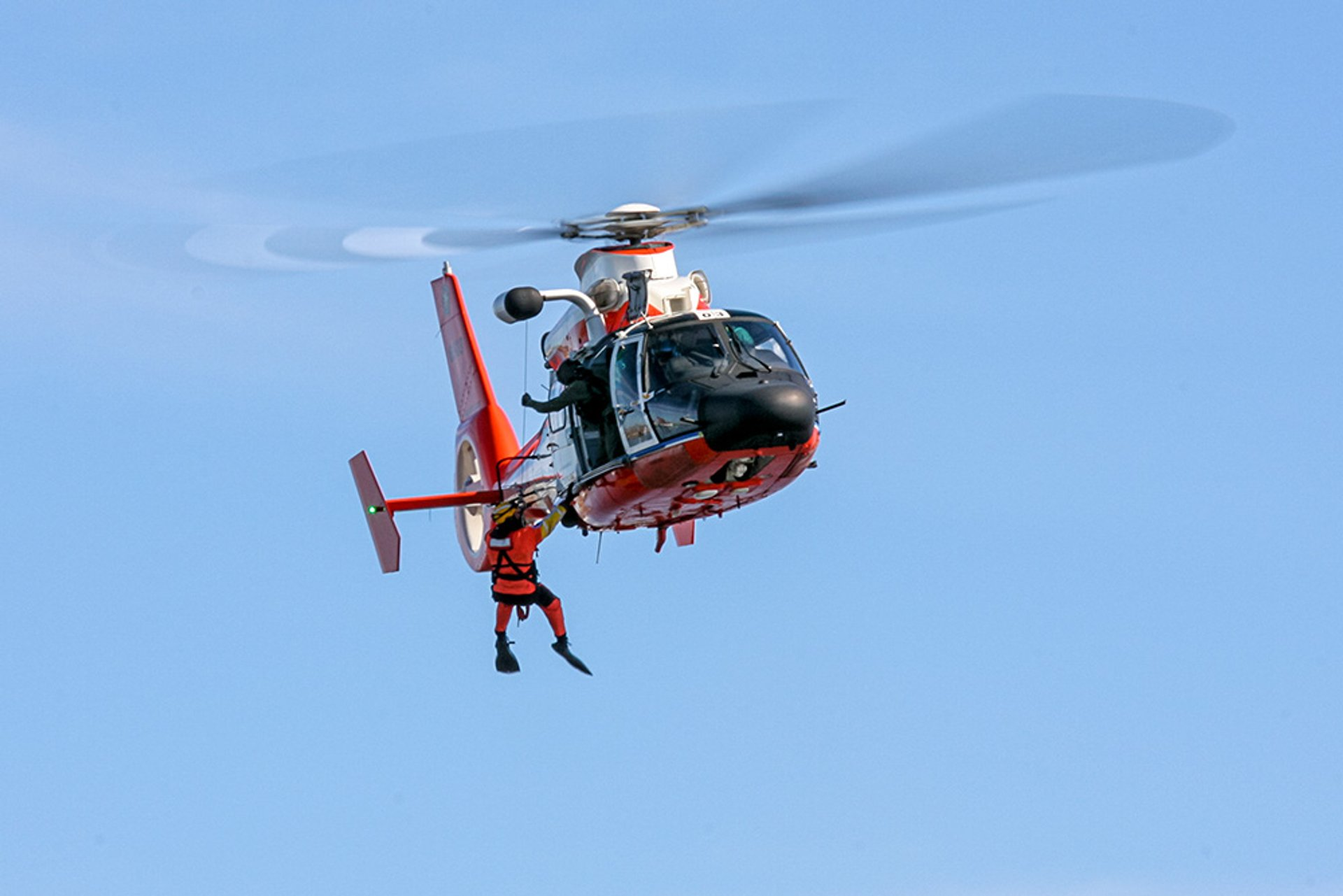 USCG SAR Demo HH-65 Dolphin conduct a rescue demonstration during rehearsal at the Baltimore Fleet Week Air Show 2020