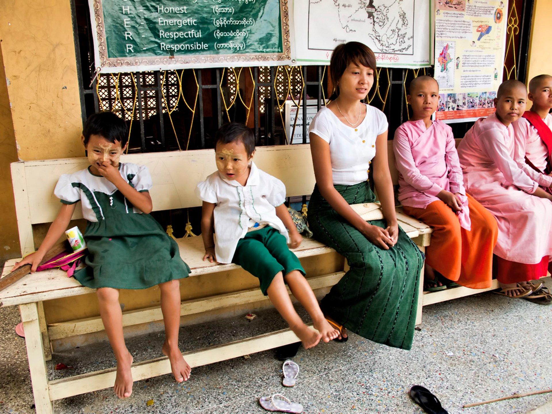 A teacher and some students at Aung Myae OO Monastic Education School, Sagaing, Myanmar 2020