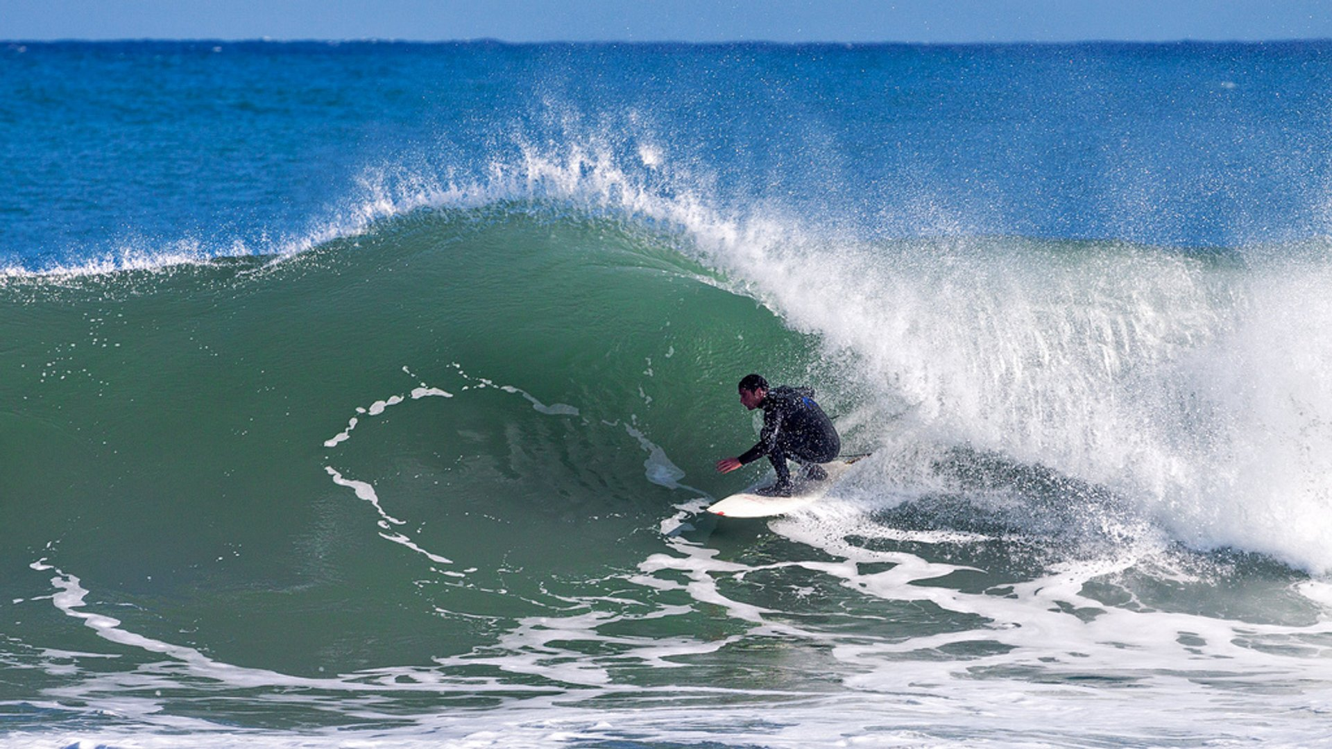 """A surfer flirting with the """"green room"""" off New Plymouth coast 2020"""