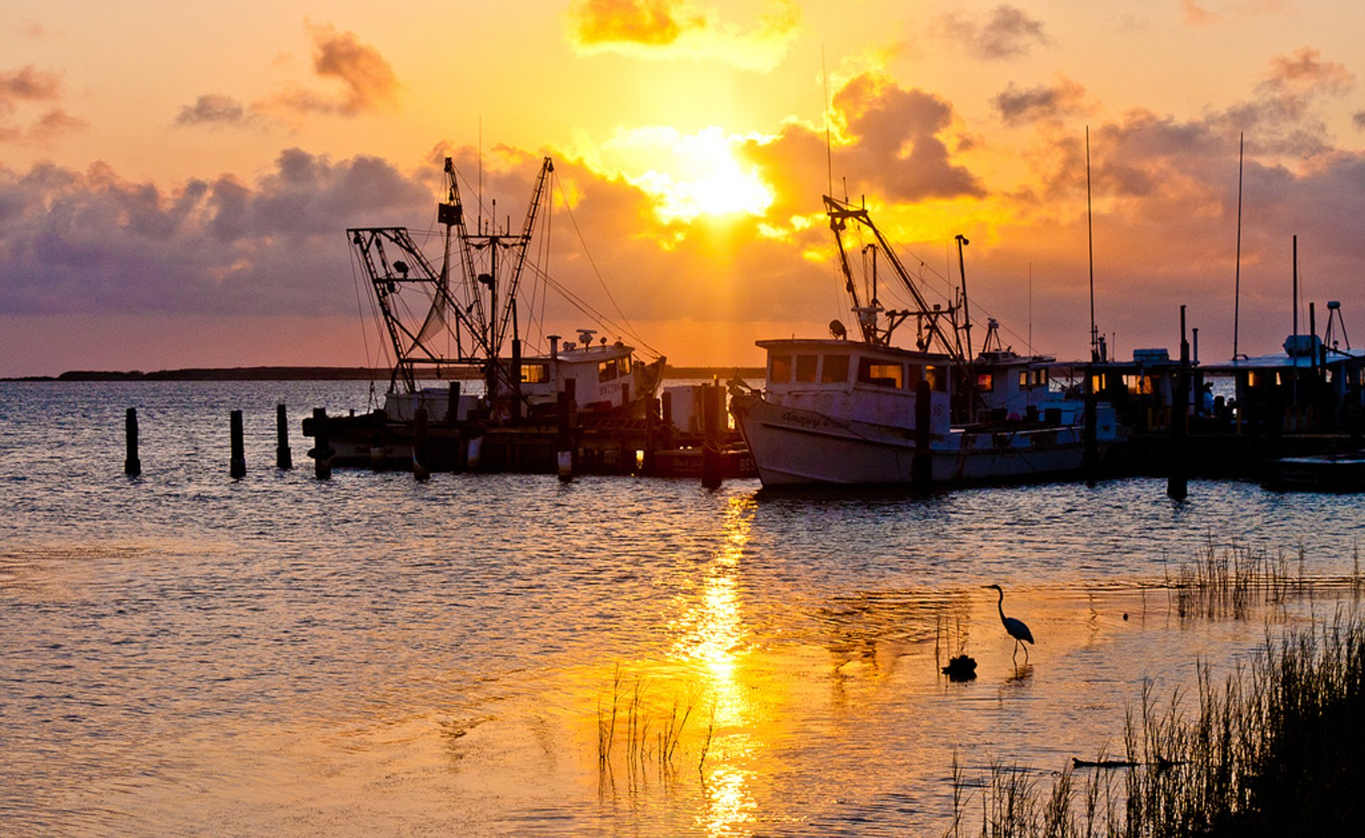 The sun sets over shrimp boats docked at Ingleside Bay 2020