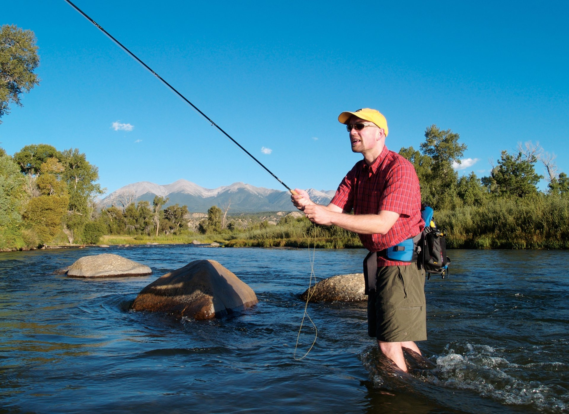 A fisherman throws in some lines in the Arkansas River near Salida, Colorado. 2020