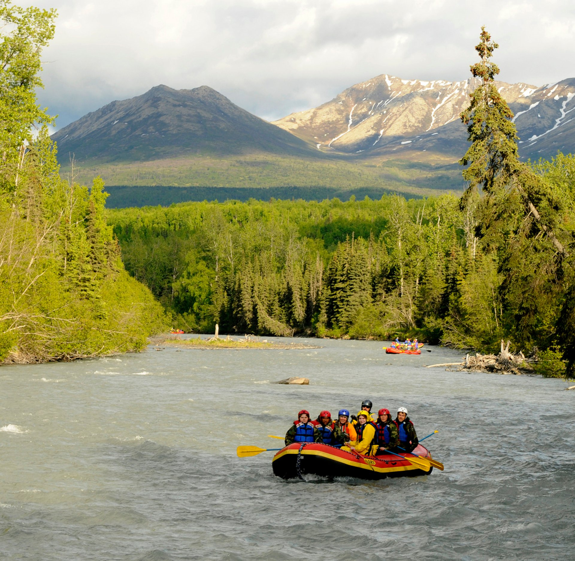 Three rafts pass through the natural beauty of Alaska during a white water rafting trip on Eagle River at Joint Base Elmendorf-Richardson 2019