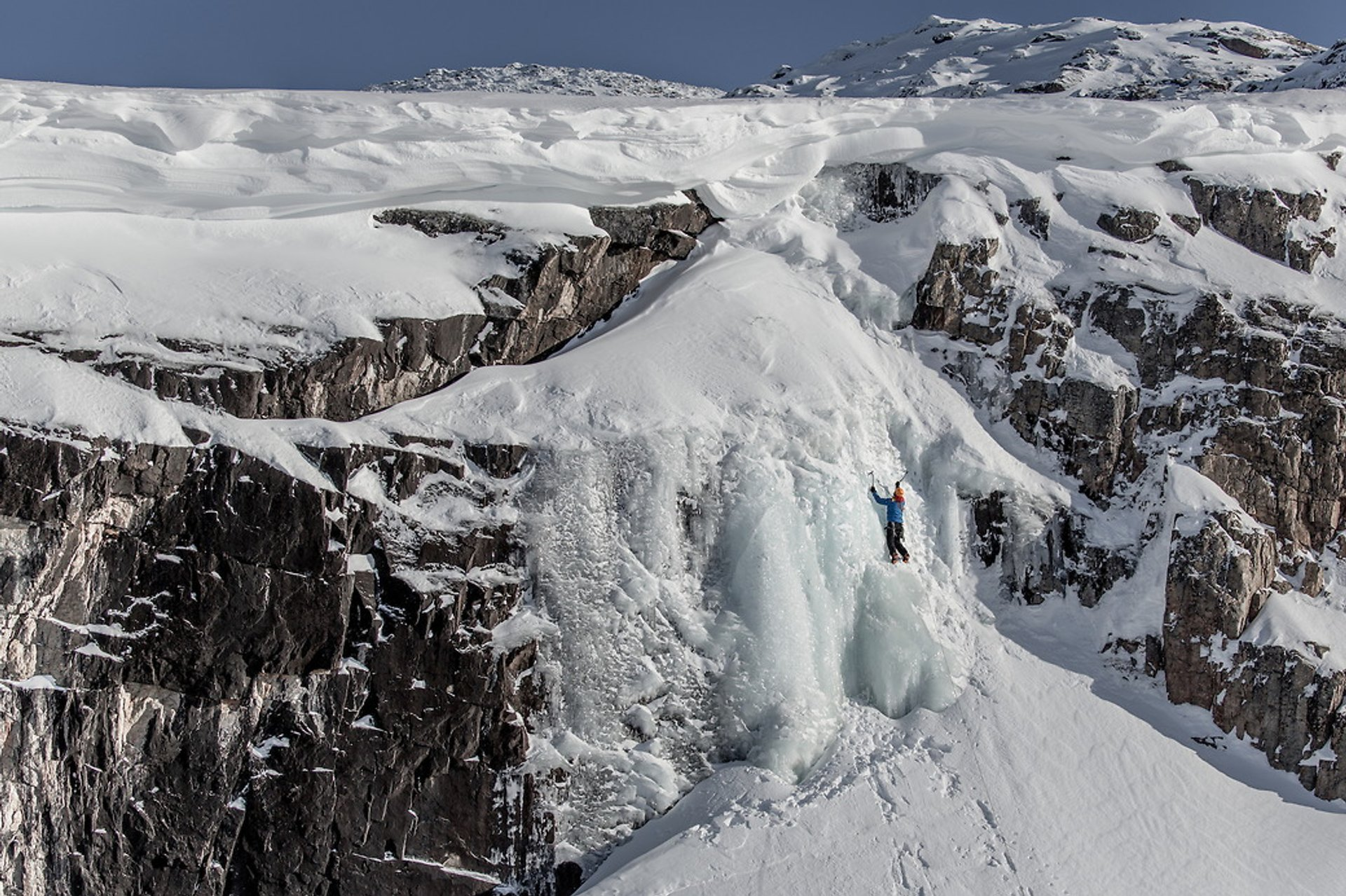 A frozen waterfall used for ice climbing near Ilulissat in Greenland 2019