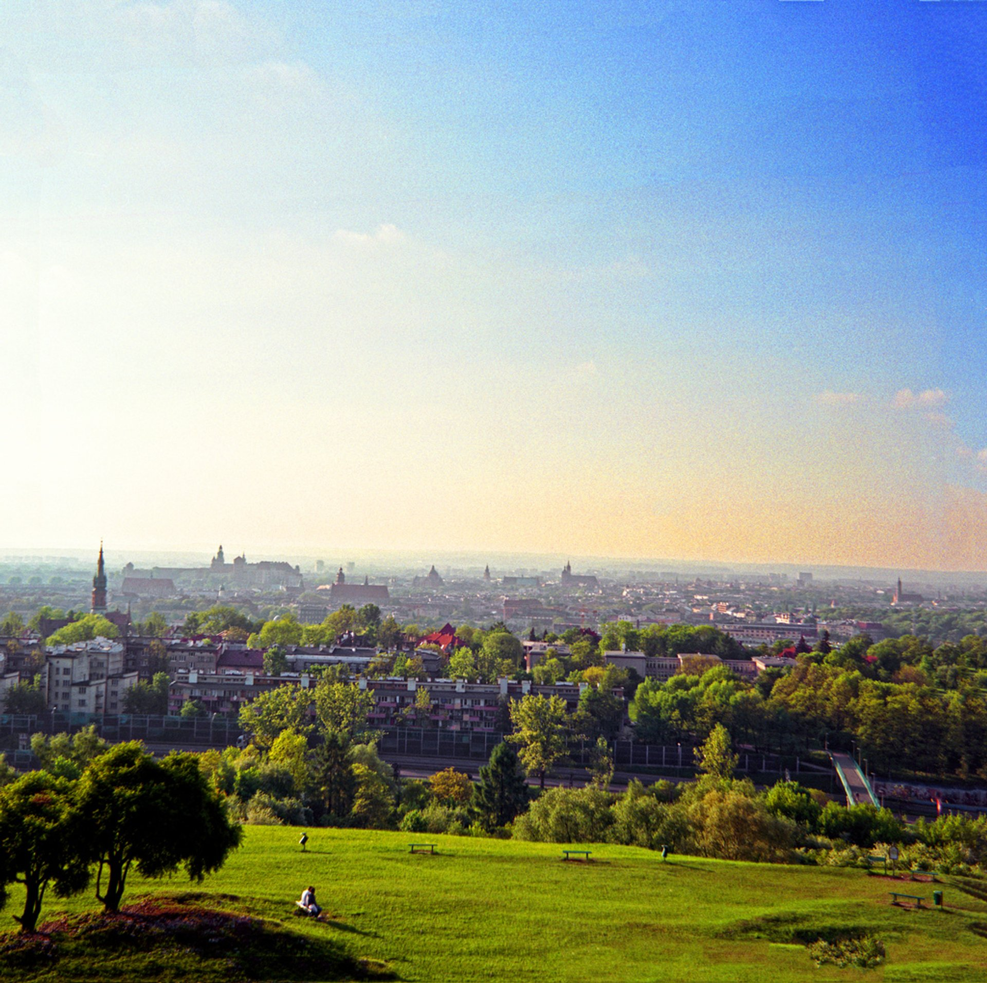 The green fields around the Krakus Mound—panorama of Krakow