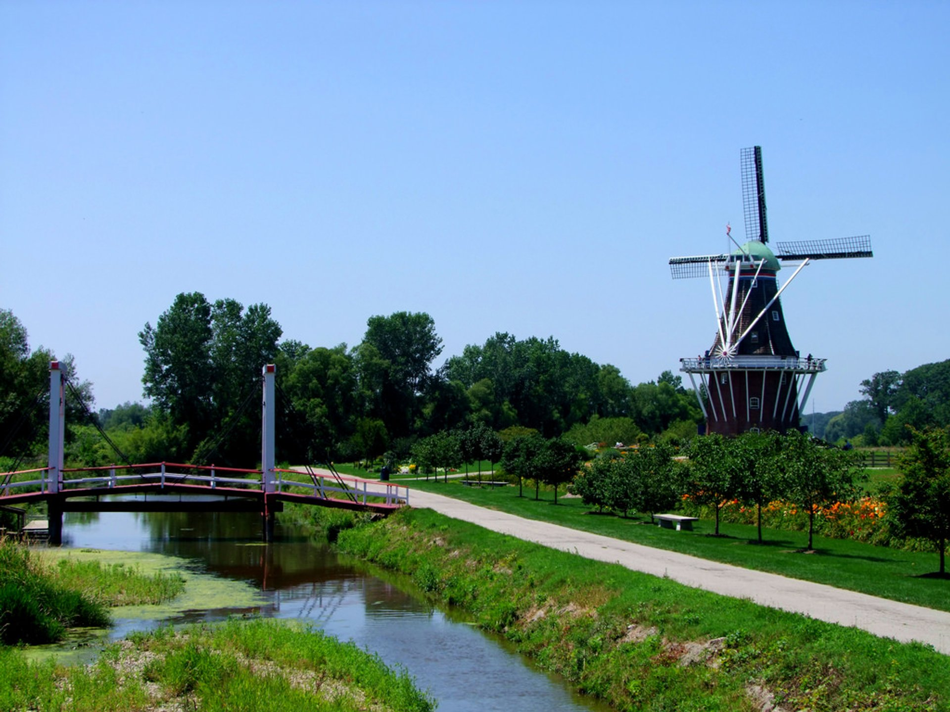 "A beautiful oasis on the edge of downtown Holland, Windmill Island features a 249 year old working Dutch windmill ""De Zwaan""  2020"