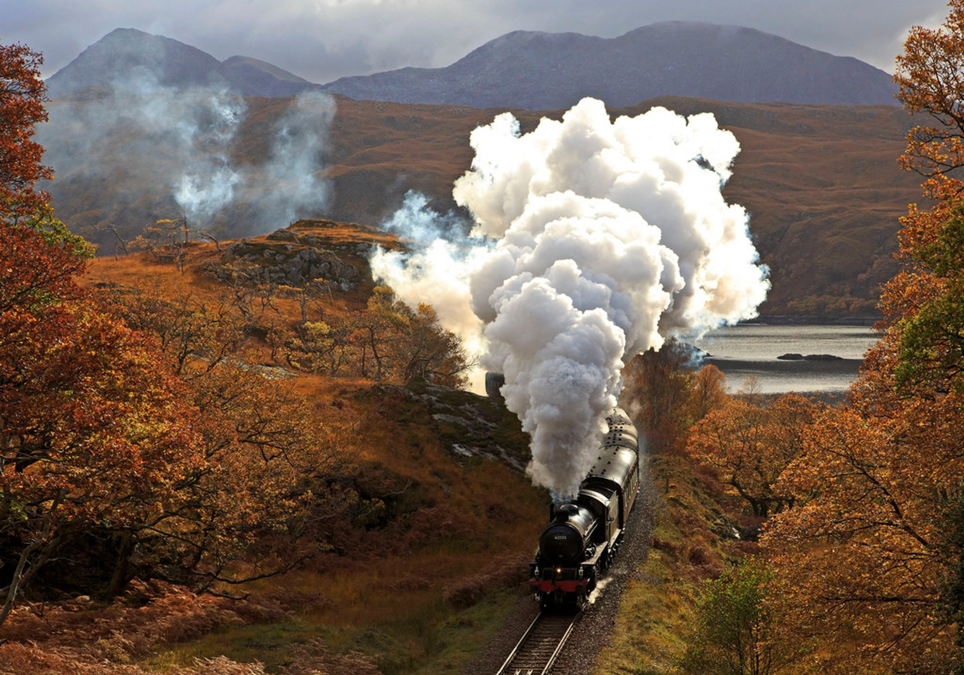 Train climbs Beasdale Bank turning away from Loch nan Uamh 2019