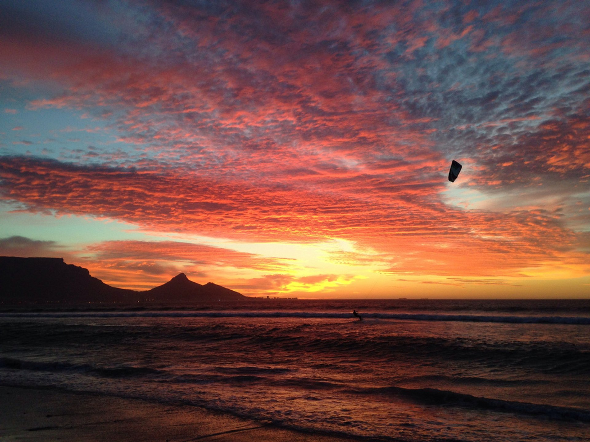 Sunset over Table Bay with kite boarders in the distance. Sunset Beach, Cape Town 2020