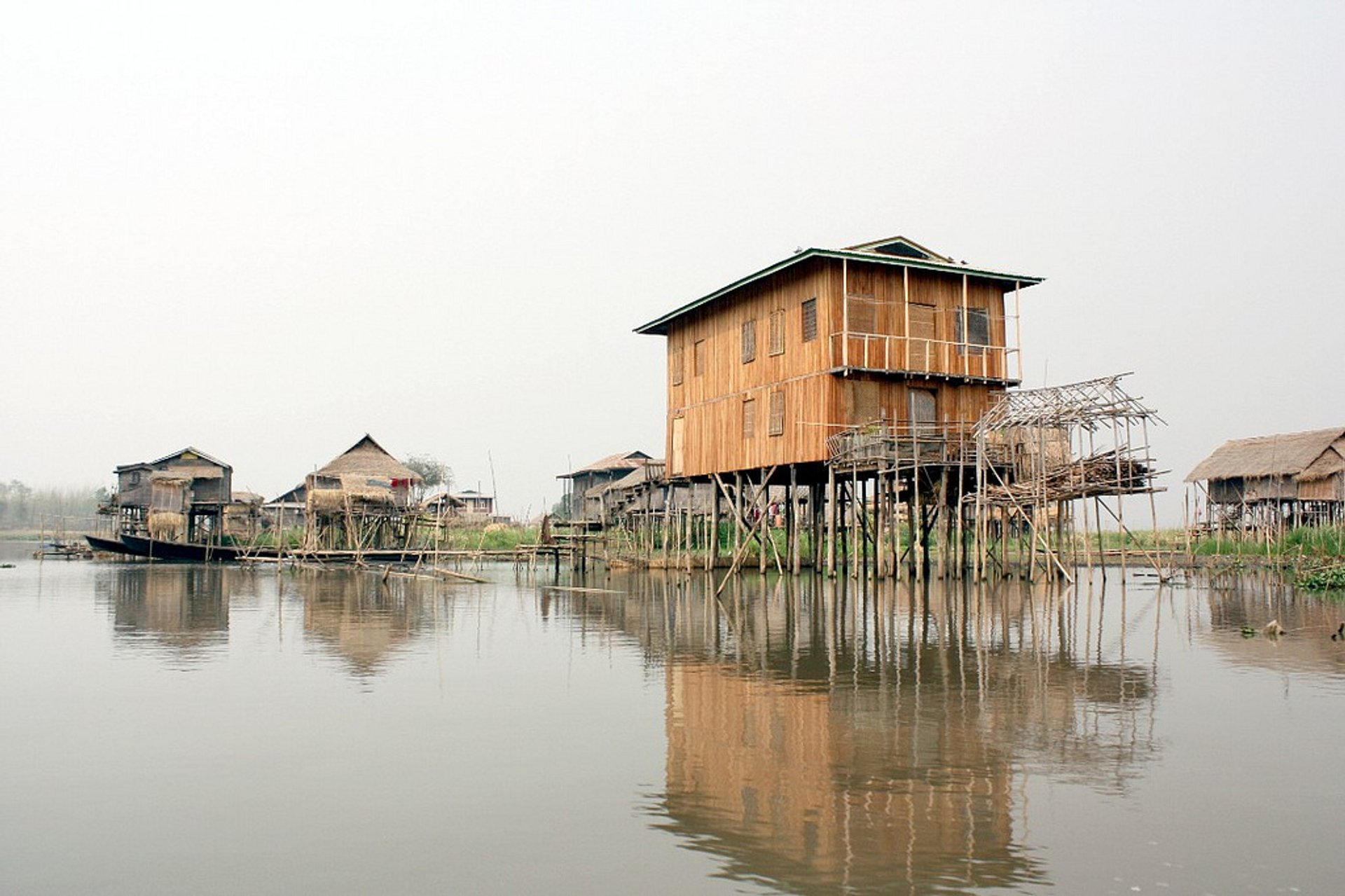 House at Thalé O village. This house is built only with wood and have many pile because the level of the lake are changing according the season. In this time the level is low because the season is dry from some month. 2020
