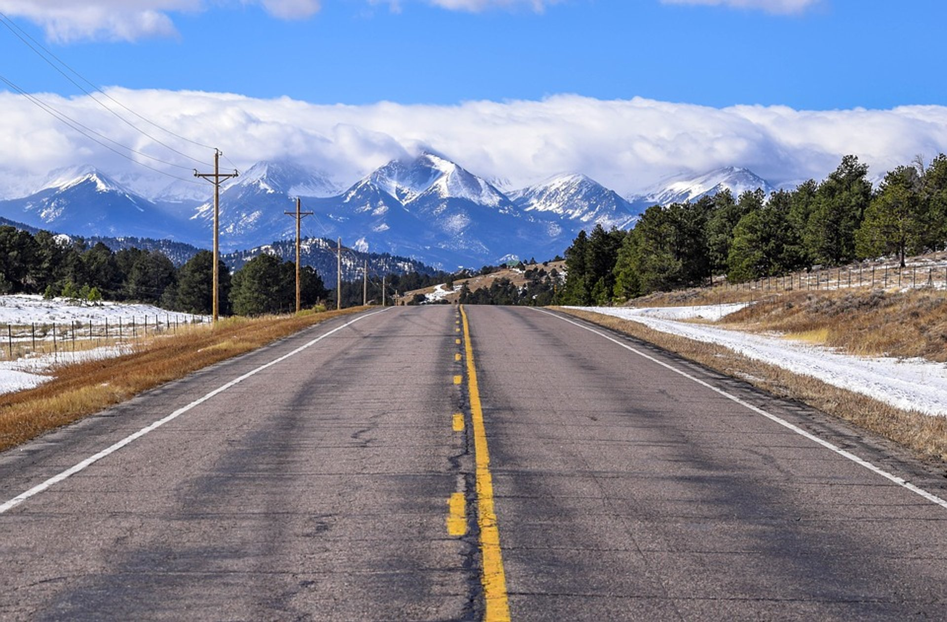 Road in Colorado with the Rockies view 2020