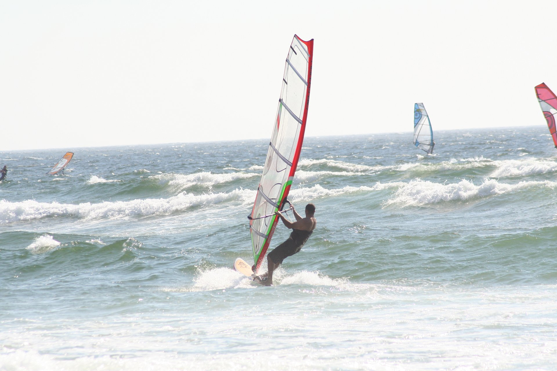 Windsurfers off the coast in Guincho, Portugal 2020