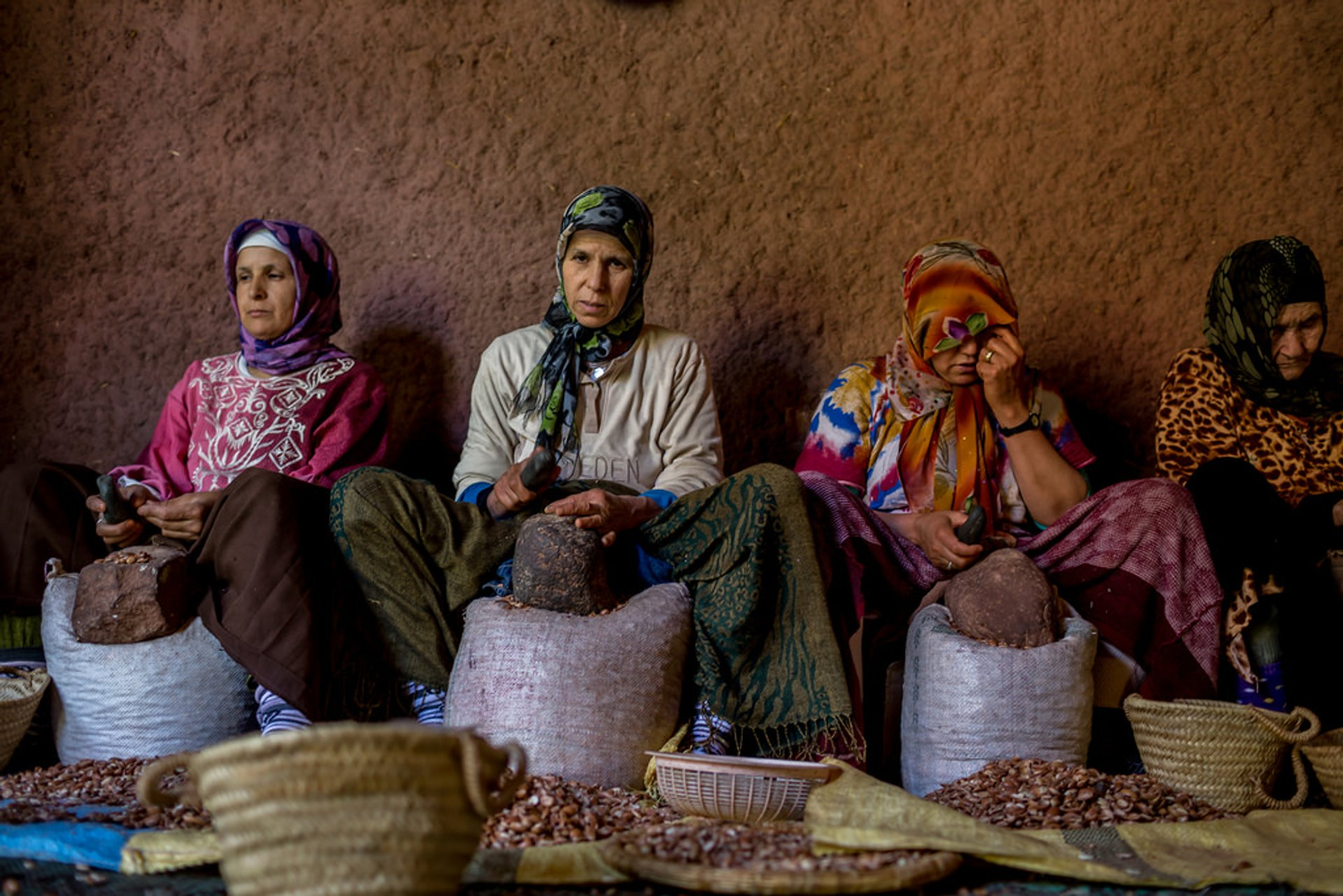 Skilled Berber women cracking argan nuts 2020