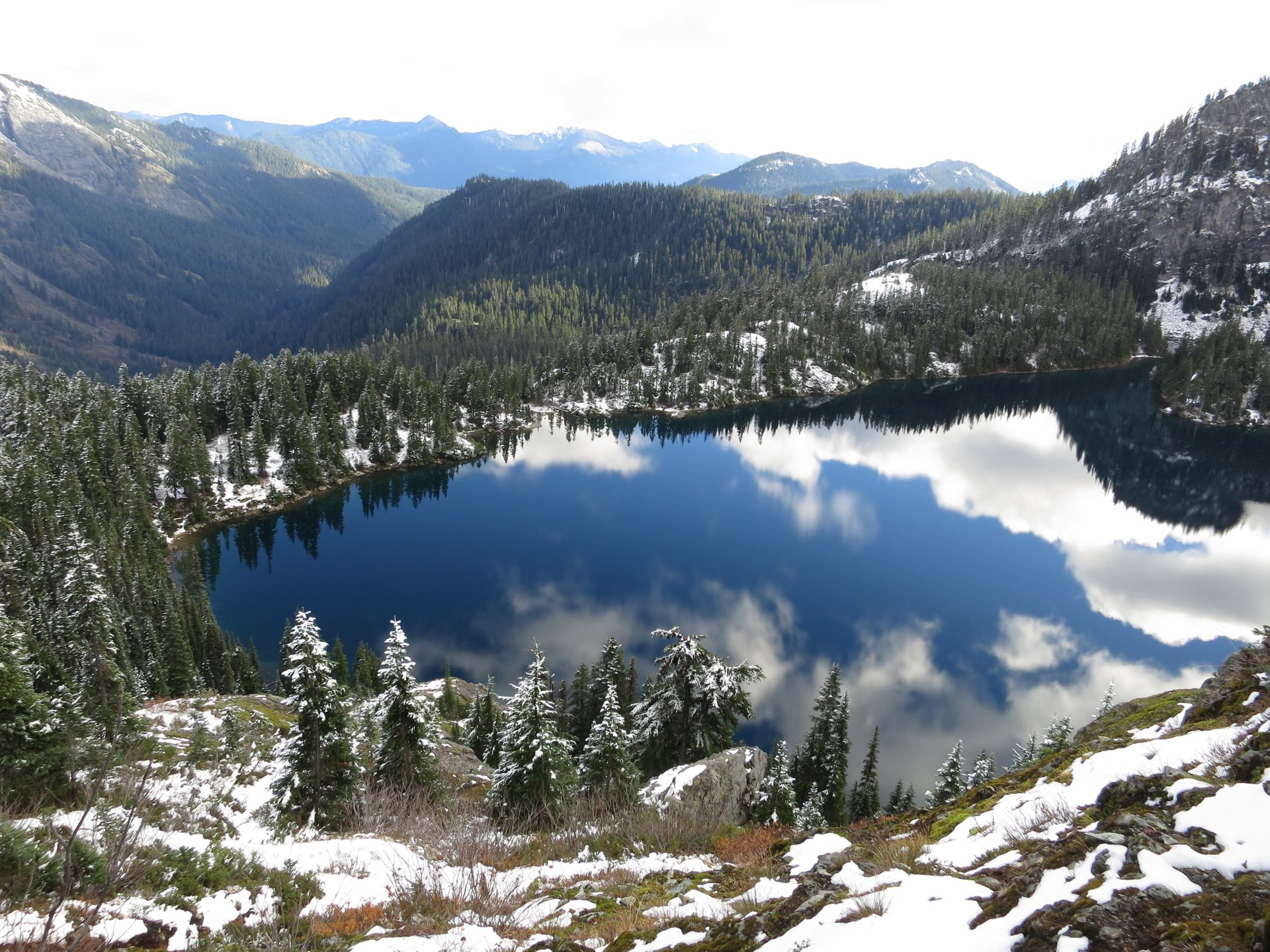 Rachel Lake as seen from above hiking up the ridge to Rampart Lakes in the Cascade mountains of Washington 2020