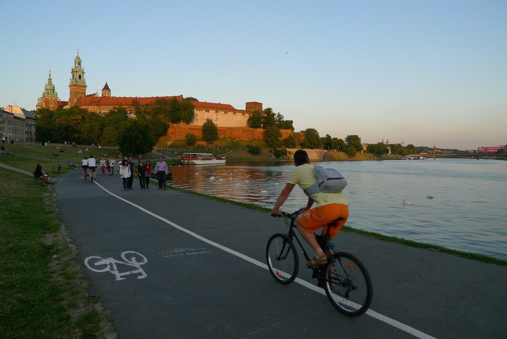 Cycling in Bulwar Kurlandzki on Vistula River close to Krakow Castle 2020