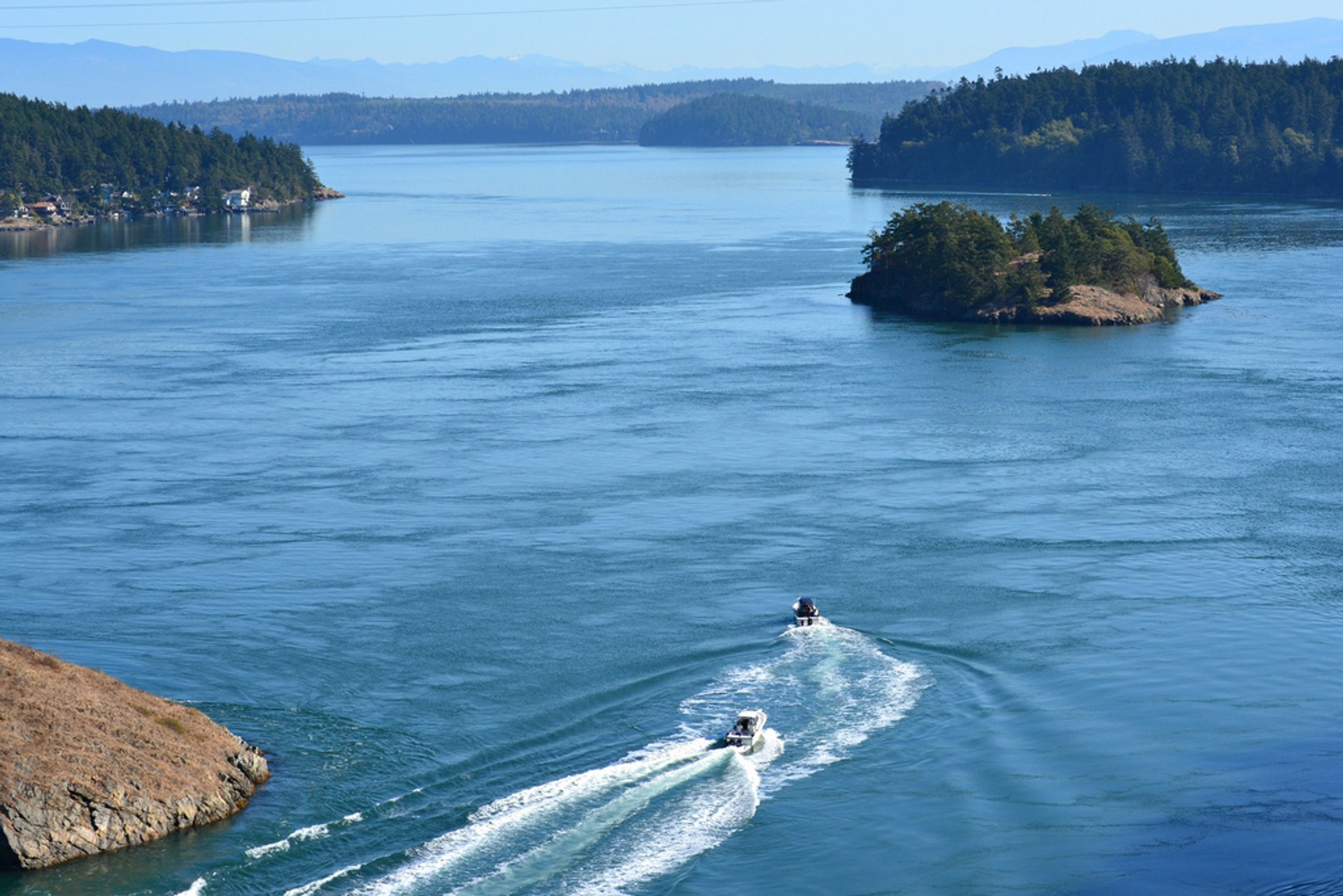 This is looking east from the Deception Pass Bridge in Washington state. The body of water is called Deception Pass and then Skagit Bay. 2020