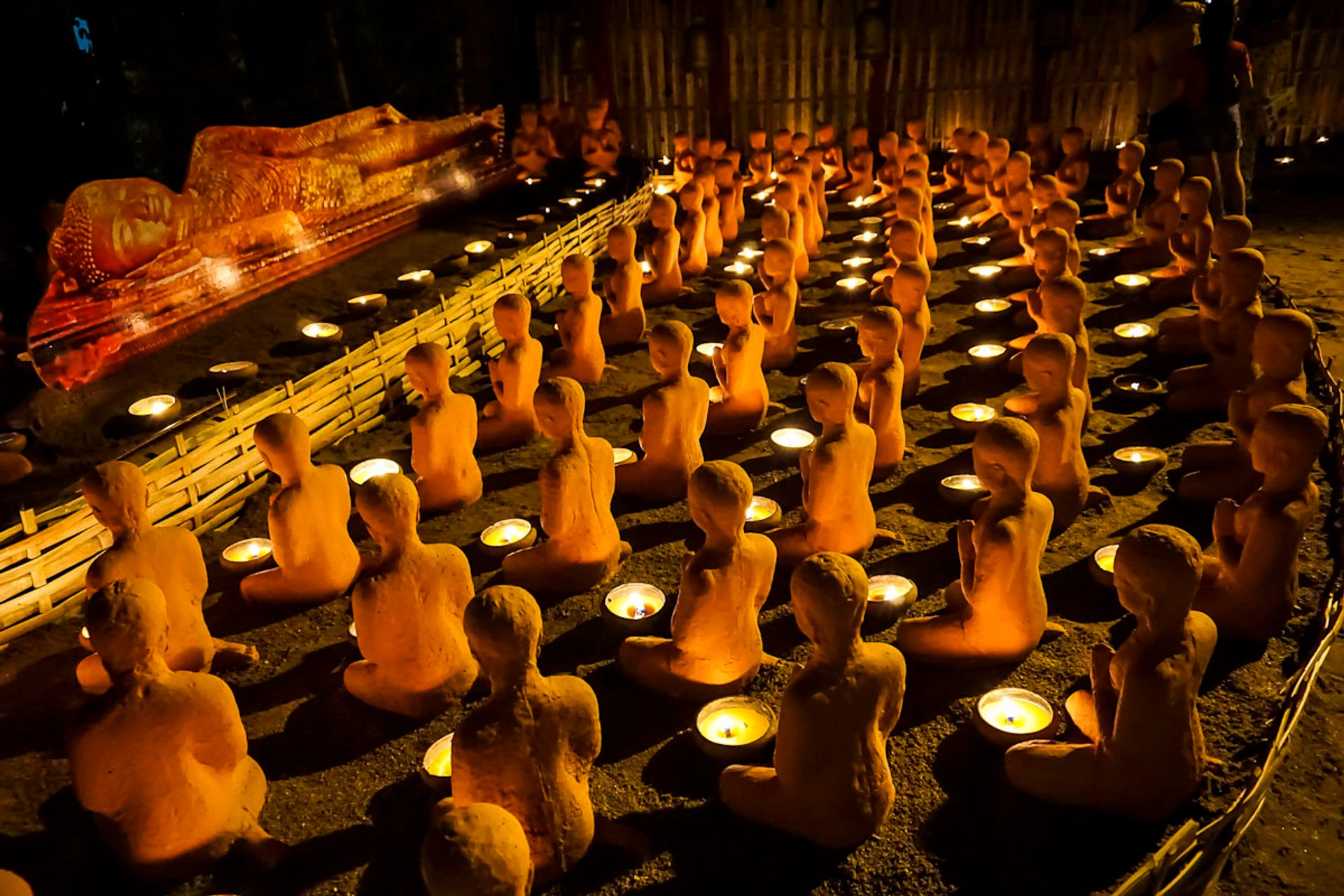 Night-time candle-lit ceremony at Wat Phan Tao on Visakha Bucha Day, Chiang Mai, Thailand 2020