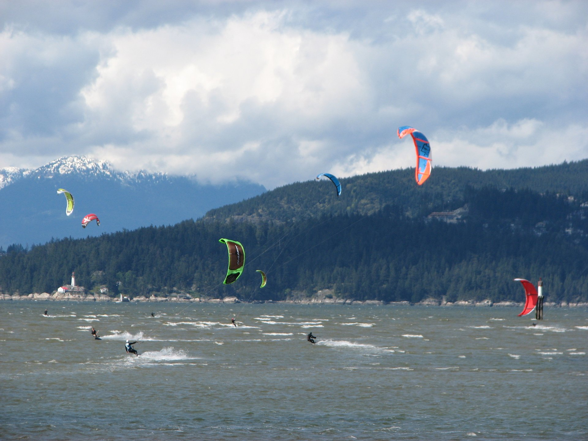 Kitesurfing on English Bay, Vancouver. Lighthouse Park in background. 2020