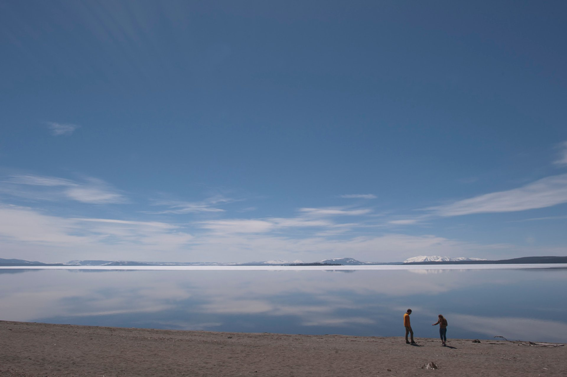 Visitors standing on the shore of Yellowstone Lake (outside the Fishing Bridge Visitor Center)