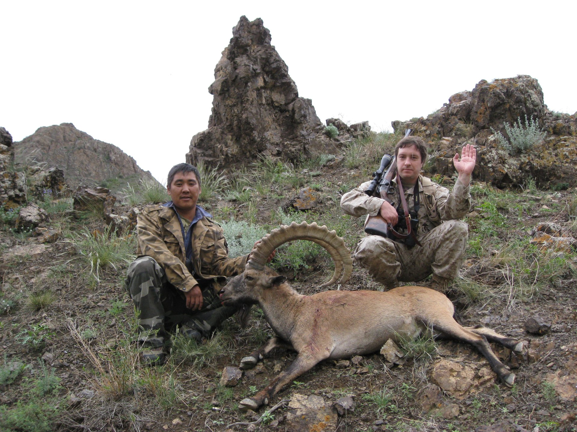 Trophy hunter with Syberian ibex (with 39 in horns) in Mongolian Gobi