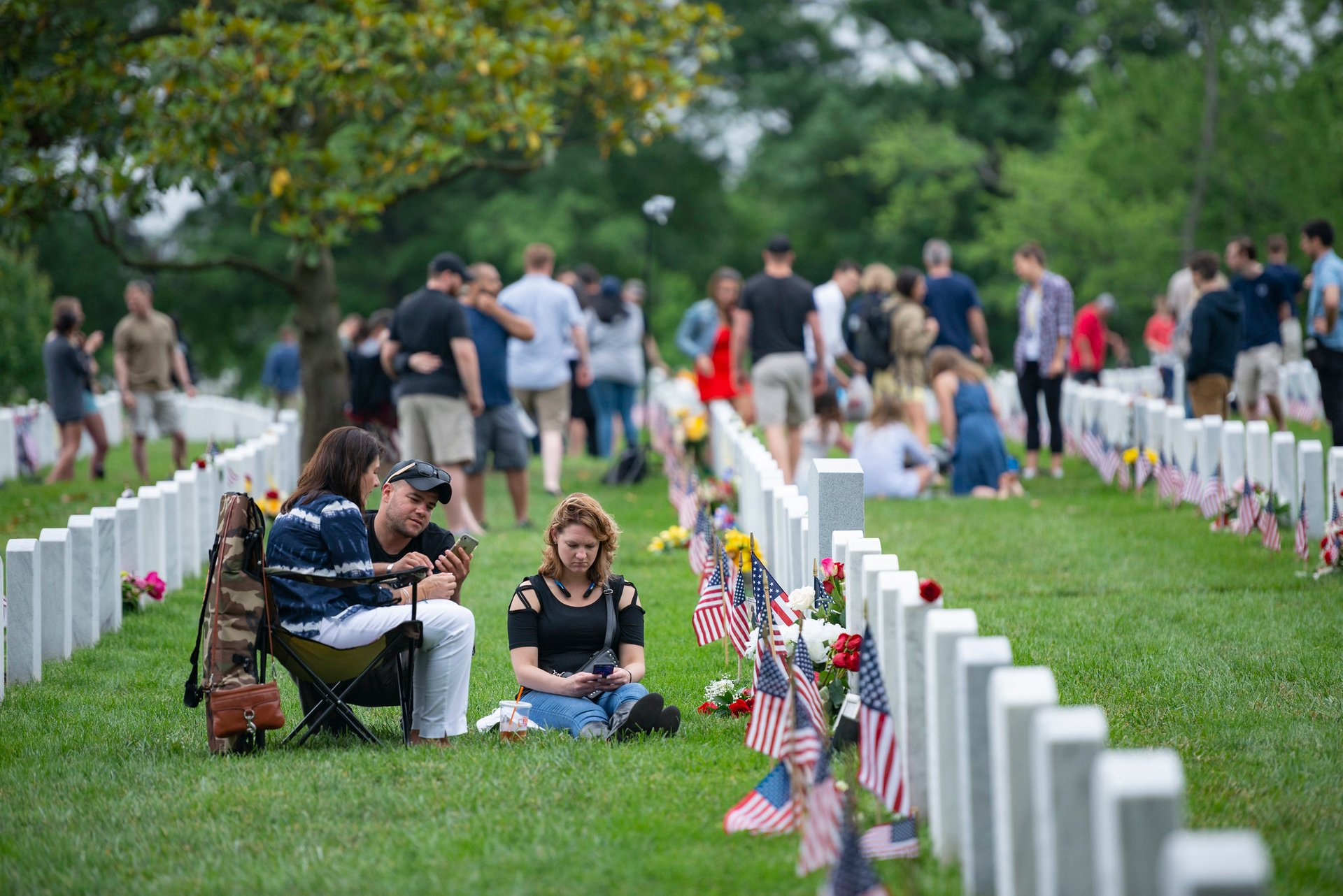 Family, friends, and visitors honor the fallen in Section 60 of Arlington National Cemetery, Arlington, Virginia 2020