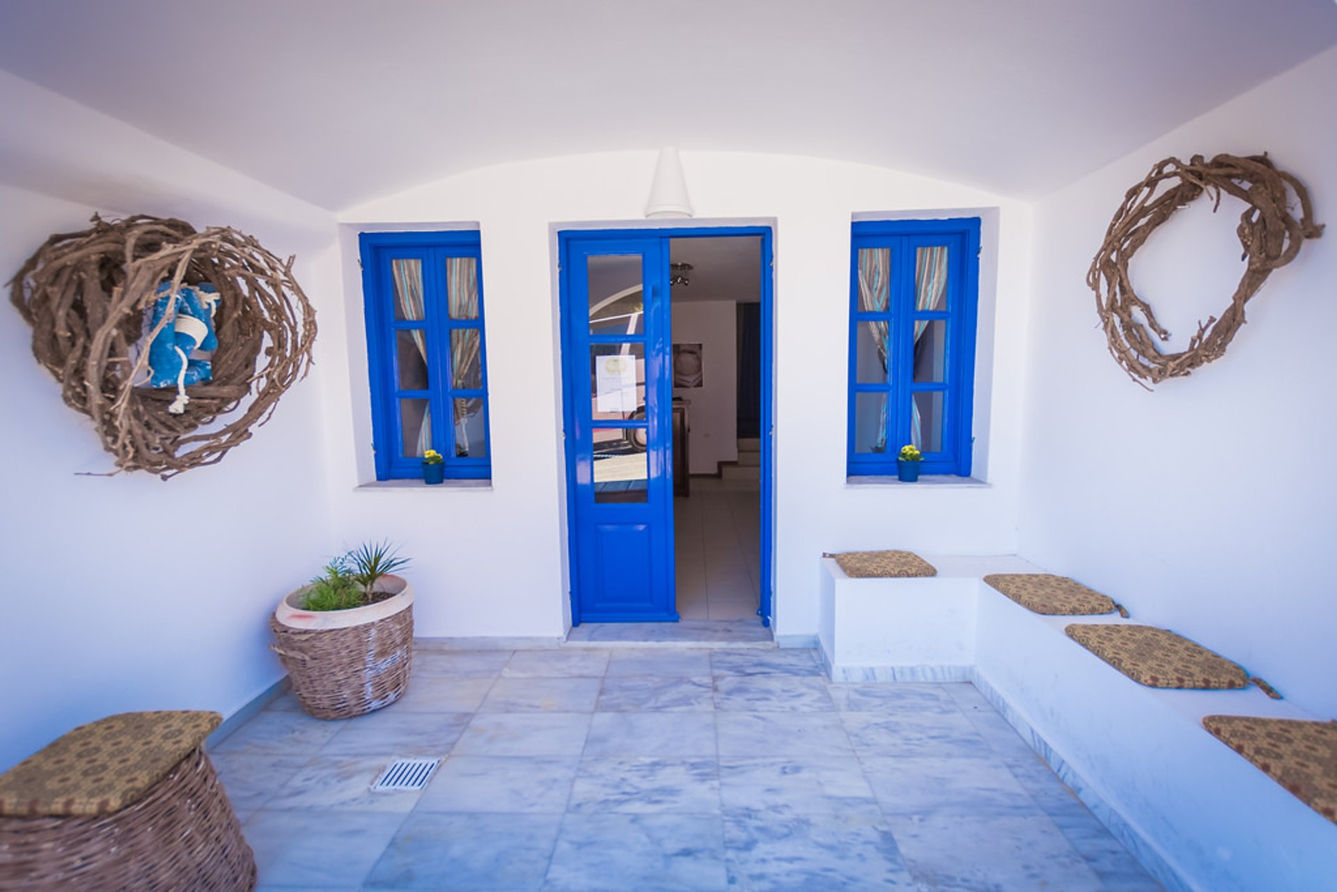 Whitewashing Houses in Santorini - Best Season 2020