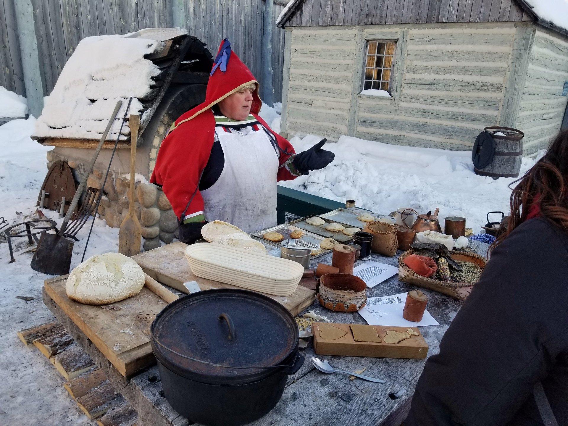 A lady explaining voyageur food at Festival du Voyageur in Winnipeg 2020