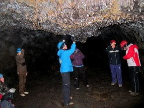Caving in Leiðarendi Lava Tube
