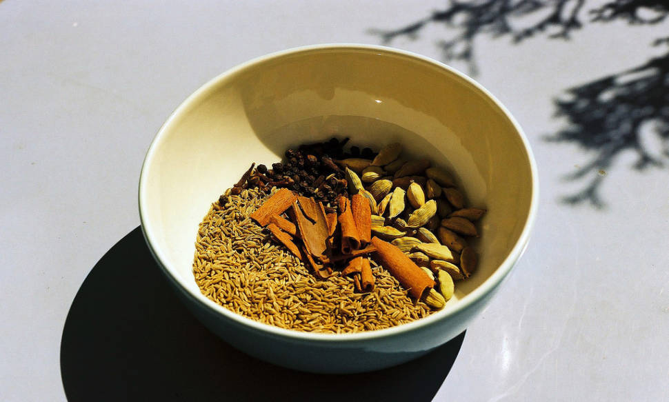 Cumin seeds, cloves, cardamom pods and cinnamon sticks—spices to be mixed with rice and cooked to make a traditional dish (Zanzibar Pilau)